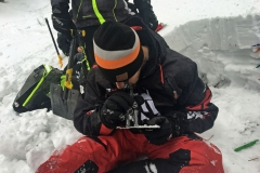 Nate Smoot, a Ride Rasmussen Style instructor studies snow crystals during an Avalanche Level 2 class instructed by Mike Duffy.