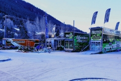 As the sun tries to peek over Snow King Mountain, the many race begin unloading their snowmobiles on Saturday morning.