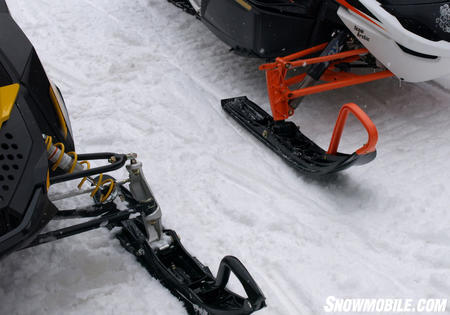 Differences in Cat�s wishbone suspension can be seen against Ski-Doo�s latest design. Note coil-over-shocks on latest REV.
