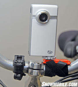 Use an 'action mount' and locate a Pure Digital Technologies Flip Video camcorder to your handlebars or helmet. (Image Courtesy Pure Digital Technologies Flip Video).