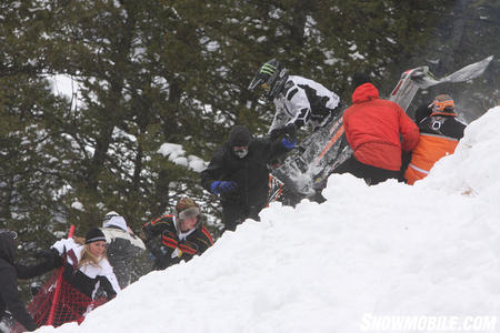 Chris Burandt and his snowmobile inadvertently dive into the crowd that stood on the side lines.