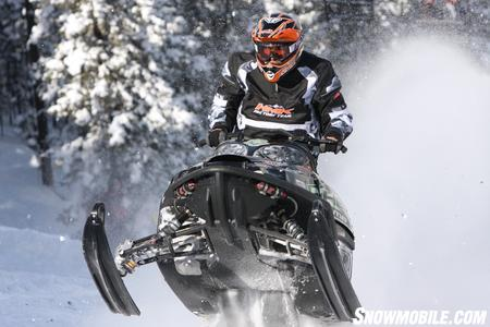 Kyle Tapio screams up the Mountain on his highly modified Arctic Cat M8.