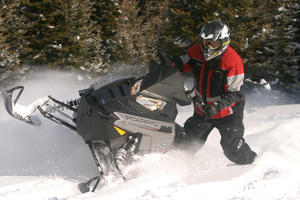 Back for 2011 is the ProTaper aluminum handlebar. The hand-warmer controls are off the handlebar down by the gas cap.