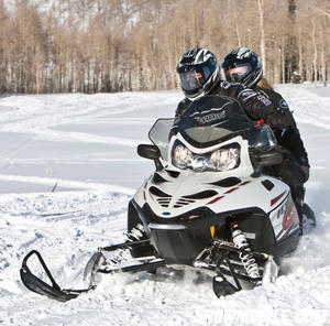 You'll find ample ride and comfort for two aboard Polaris' fan-cooled trail cruiser.