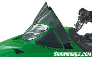 Low and sporty windshields don�t deflect much powder, but the black Frog Skinz used to cover the side vents do keep snow and moisture out from under the hood.