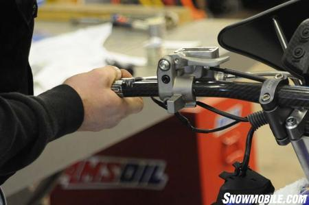 Check the operation of the brake. The lever should be firm, not spongy. It's best to check the brake again on a warm-up stand before you ride, too. The RSI braided line doesn't expand like the stock rubber line, so the brake will be firmer and more precise.