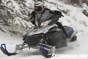 Rider forward ergonomics and curved handlebar lets riders be aggressive on tight trails.