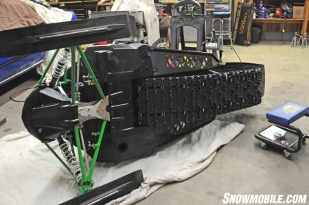Lay out an old blanket, piece of carpet or cardboard and flip your sled on its side. Your sled will be getting moved around a lot while on its side and you don't want it to get scuffed up on the shop floor. A moving blanket works nicely for this.