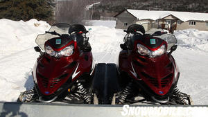 Redline Snowmobiles on Trailer