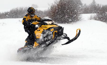 2013 Ski-Doo MXZ TNT 800 E-TEC tailstand in snowstorm