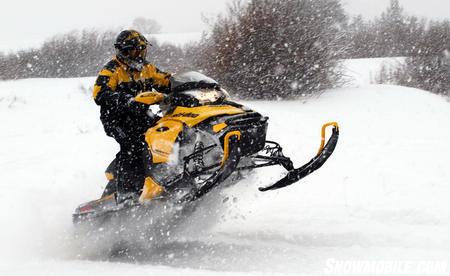 2013 Ski-Doo MXZ TNT 800 E-TEC tailstand in snowstorm