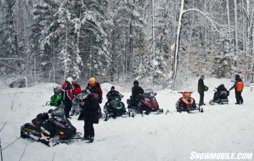 Ontario Snowmobilers Checking Mobile Trail Guide