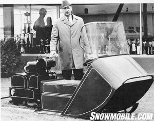 Allan Hetteen stands alongside the second ever Polaris snowmobile.