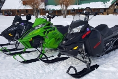 The three test units in front the Box Y Lodge, near Alpine, WY. Background, Polaris AXYS RMK Pro 163, middle, Arctic Cat M8000 Limited 162, and foreground, Ski-Doo XM Summit SP 163. All units with three-inch paddle tracks.