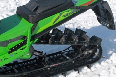 Deep three inch lugs, or 2.6-inch lugs from the PowerClaw track gives the MC 8000 momentum to climb high and go deep. Note the open hyfax rails.  Note the standard tunnel bag.