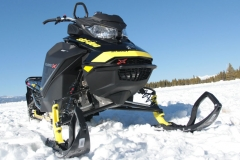 The RAS-3 front suspension with coil-over KYB shocks provide excellent bump-soak capabilities, but the RAS-3 front mostly resists handlebar slap, and contributes to the Summit's airy feel through the handlebars.