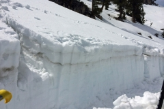 A snow stability test cut into a slope reveals where a slope is most likely to slide.