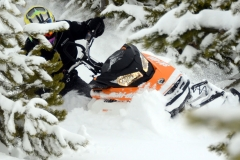 The RMSHA hillclimber student takes a G4 Summit X through some steep terrain where the trees are thick. This is do or die. The Ski-Doo G4 Summit X makes this game, easier to win.