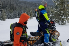Luke Read (standing) and Aaron Roesler use the mountainside as their classrooms.  From the Ski-Doo G4 Summit X, both Read and Roesler, with tutoring from Rasmussen, teach fundamentals to both novice and experienced riders.