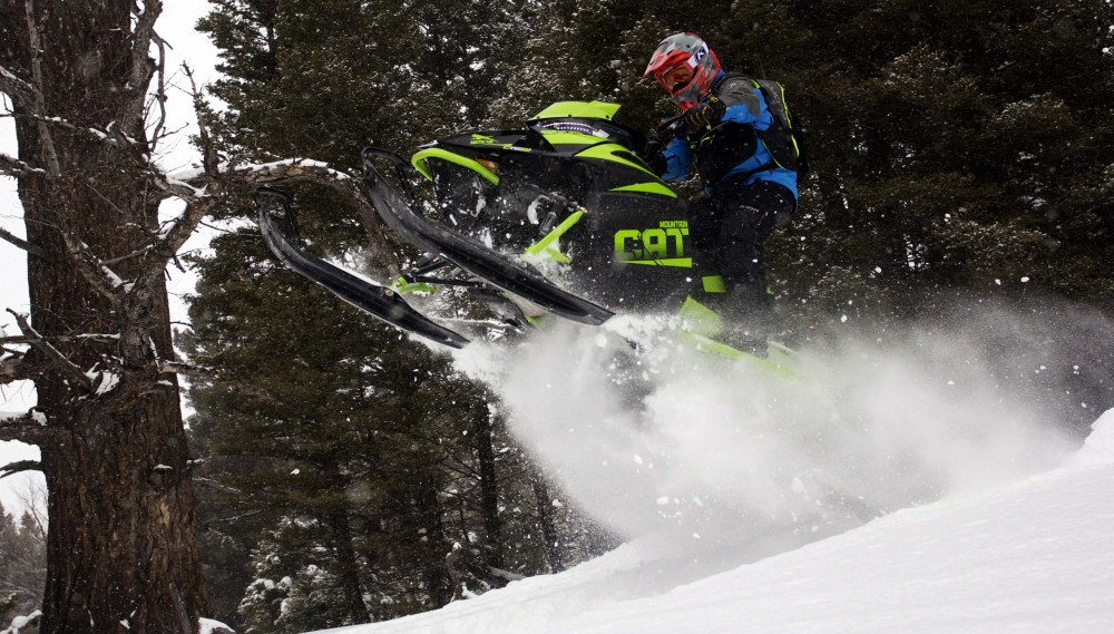 When taking on large deadfall trees, the new domestic built motor from Arctic Cat digs deep and low with mountainous grunt to launch the Mountain Cat up over the large obstacles.