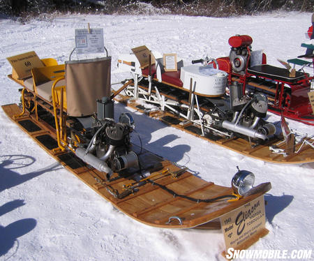 A few of the Eliason models owned by Wayne & Sherry Campbell of Millinocket, ME: (Left) 1945 Eliason Motor Toboggan Model D; (Right) 1943 Eliason Motor Toboggan Military C (Image courtesy of Jay Egan).