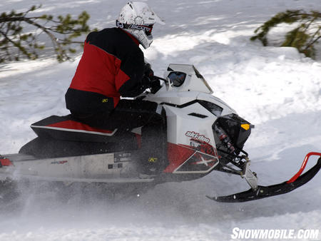 Ski-Doo's REV models create a perception of a short sled, but note the ample track length behind the rider.