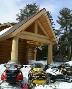 Snowmobiles parked outside of Laurentian Lodge.