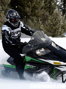 Test rider Doug Erickson hits the throttle and easily pushes the 2011 F8 EXT through powder.