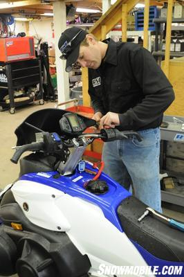 Rob Schatzle cut his teeth wrenching at snowmobile and Jet Ski races. These days he spins wrenches for the Hentges Racing snocross team on the ISOC National circuit is also the owner of RSI Racing. Who better to install the bars on our sled? Rob starts by removing the stock controls. Yamaha controls are two-piece and simply clamp down over the bars with Phillips head screws.  Most sleds are like this for ease of assembly at the factory.