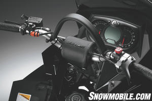 The Summit X handlebars are tapered aluminum and highlight this powder sled's style.