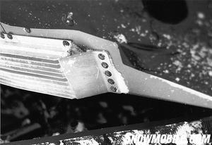 To keep the 650cc triple cool, Polaris used aluminum extrusions mounted under the runningboard.