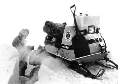 Members of the Plaisted Expedition bridge ice ridges on their way to the North Pole.
