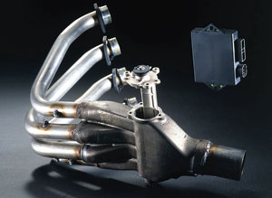The EXUP system on a four-cylinder motorcycle engine also fits between the headers and the muffler junction.