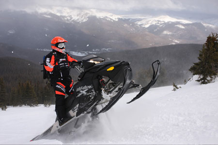 The Summit X 800 shows off its tail walking capabilities in the Colorado powder.