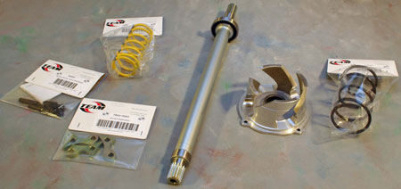 The TEAM XP Conversion kit includes from left to right the TRA primary pin kit, ramps, and spring, hollow jackshaft with bearing, Twin Trax helix, and helix spring.