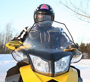 Tall Cobra windshield directs airflow off the body and hands and over the head.