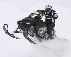 Test rider Kevin Allred is pleased with the raw horsepower of the Ski-Doo Summit X even at very high altitudes.