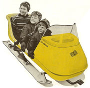 Early tow-behind sleighs featured leafsprung skis and room for three kids.