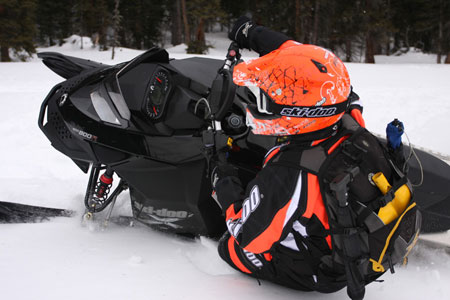 Ski-doo engineer Chris Ruske breaks it loose on an 800 Summit X.  Ski-Doo continues its quest to improve the REV XP chassis.