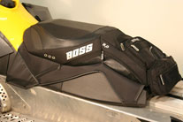 Modern snowmobilers can add storage and maximize their ride with BOSS specialty seats. (Image courtesy of BOSS Seats.)