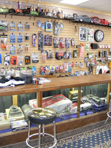 The parts counter gets to be a busy place to 'talk' snowmobiling during the season.