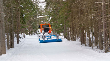 Ontario has a fleet of 302 groomers to provide snowmobilers with a smooth ride.