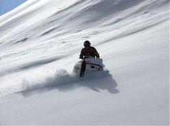 Erik Woog heads off into the Colorado Rockies near his shop.