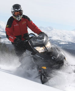 Snowmobile.com mountain rider Kevin Allred uses techniques taught by Bret Rasmussen to shake down the latest deep powder models.