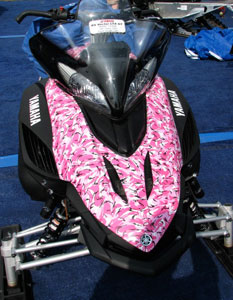 "With approximately 12 percent of all active snowmobilers being female, should sled marketers look at offering more than ""pink"" graphics?"