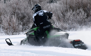 Serious snowmobilers prefer power to churn in powder.