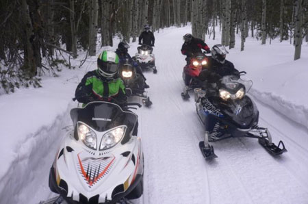 "The crews get out on the trail for a real ""hands on"" snowmobile session."