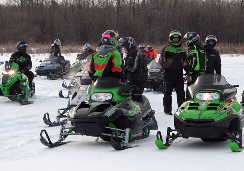 Snowmobilers Gather on a Frozen Lake