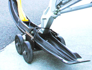 The dollies fit virtually all skis and allow you to drive your sled from trailer to shop. (Image courtesy of Recreational Necessities Sure Grip.)