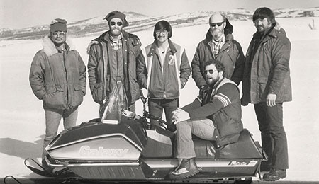 The 1979 Team Galaxy test crew consisted of (left to right): guide Sig Larsen, Polaris national service manager Bow Crosby, technician Moses Anvil, Jr., Polar Equipment marketing manager Ron Allen, Polaris cross country racing coordinator Ray Monsrud, and (seated) Snowmobile.com senior editor Jerry Bassett.
